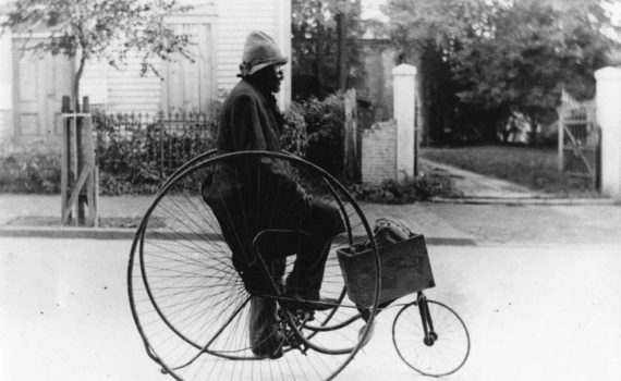 Man riding Victor Tricycle Victor Co tricycle at unidentied location in Georgetown, c. 1890-1900.