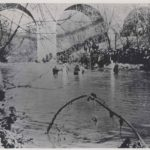 Mass baptism in Rock Creek next to the Q Street bridge in the 1920's