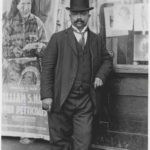 George Martin, manager, in front of the Blue Mouse Theatre on 26th Street, c. 1914-1928.