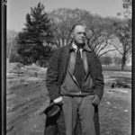 Photo of Archie Alexander, senior partner in the firm of Alexander and Repass of Des Moines, Iowa, Roger Smith, photographer, United States. Office of War Information. March 1943.